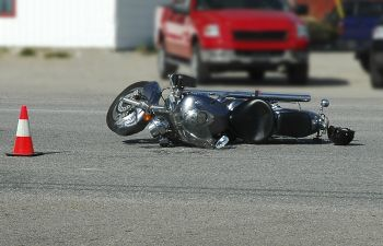 motorcycle and crashe helment lying on the road after auto accident