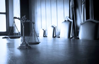 justice scales on the desk in the courtroom