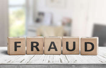 Fraud sign made of wooden blocks